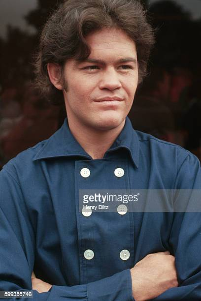 The Monkees' Micky Dolenz crosses his arms between takes on the band's television show