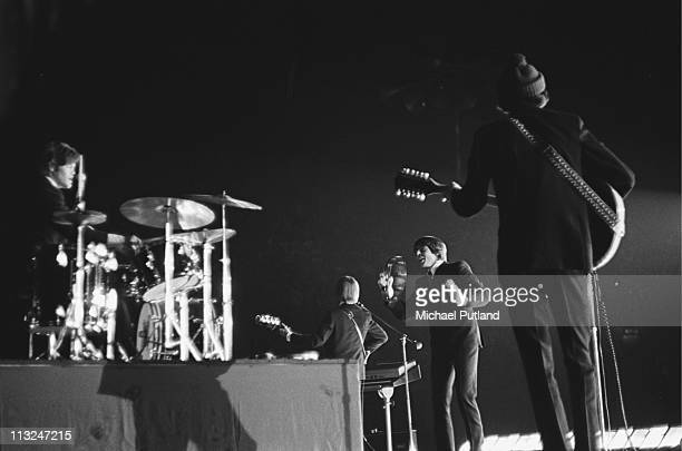 The Monkees perform on stage at Wembley Empire Pool London July 1967 Mickey Dolenz Peter Tork Davy Jones Mike Nesmith