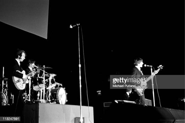 The Monkees perform on stage at Wembley Empire Pool London July 1967 Mike Nesmith Mickey Dolenz Davy Jones