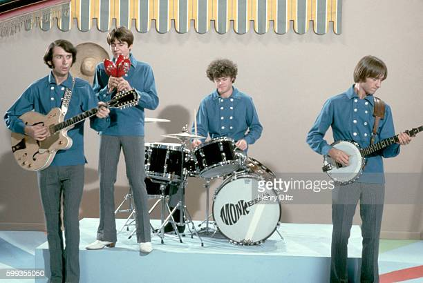 The Monkees perform on their television show wearing matching blue shirts