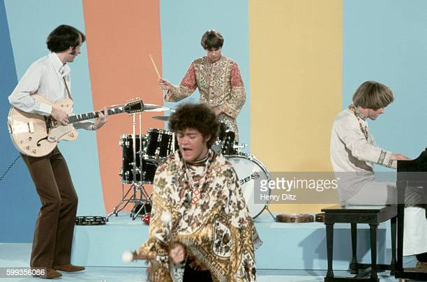 The Monkees play instruments and goof off on their television show