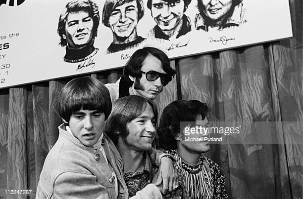 The Monkees pose at a press conference at The Royal Garden Hotel London 29th June 1967 LR Davy Jones Peter Tork Mike Nesmith Mickey Dolenz