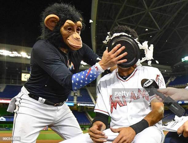 The Monkey arrives to pie in the face Yadiel Rivera of the Miami Marlins after getting a walk off single in the tenth inning against the at Marlins...