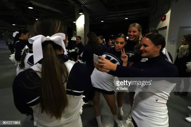 The Monmouth Hawks cheerleaders take a selfie before the game against the Kentucky Wildcats at Madison Square Garden on December 9 2017 in New York...