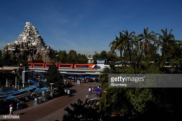 The monorail arrives in the Tomorrowland station past the Matterhorn at Walt Disney Co's Disneyland Park part of the Disneyland Resort in Anaheim...