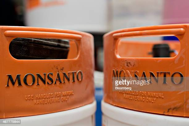 The Monsanto Co logo is displayed on chemical barrels at the Crop Protection Services facility in Manlius Illinois US on Friday March 20 2015...