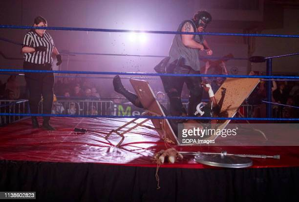 The Monster Abyss slams the The Voodoo King Mojo McQueen onto a table and thumbtacks in a Monster's Ball Match during the Rival Showdown Pro...