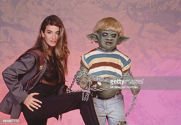 The monster puppet Scrondo and the actress Eva Robin's in a photo shooting for the show 'L'Araba Fenice' broadcasted by Italiauno Italy April 1988