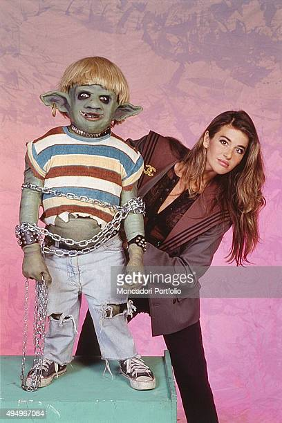 The monster puppet Scrondo played by italian actor Ivano Spano and the actress Eva Robin's in a photo shooting for the show 'L'Araba Fenice'...