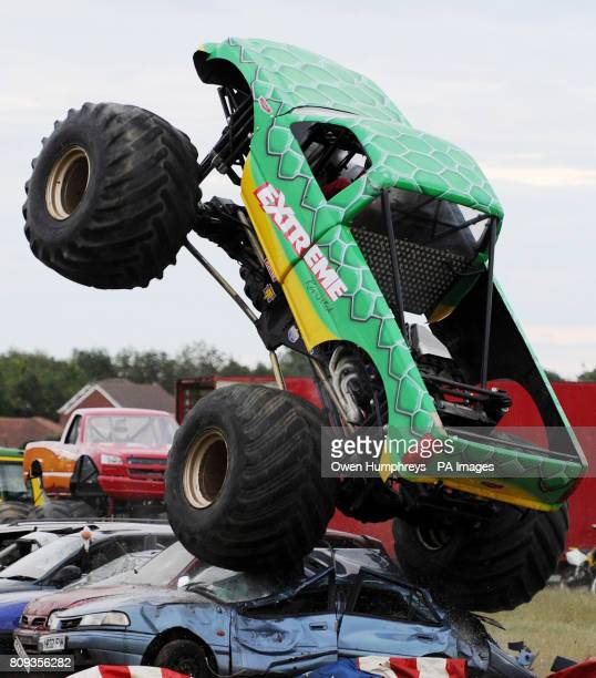 The Monster Truck from The Extreme Stunt Show drives over vehicles at a performance at Earsdon North Tyneside during their UK tour