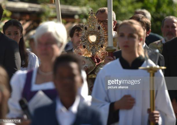 The monstrance is carried towards Staffelsee lake during the Corpus Christi procession in Seehausen Germany 15 June 2017 Subesequently decorated...