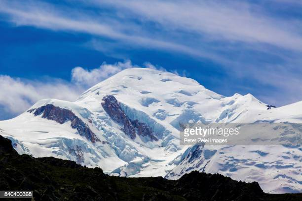 the mont blanc, the highest mountain in the alps and in europe - mont blanc massif stock photos and pictures