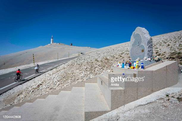 """The """"Mont Ventoux"""" mountain : cyclists climbing the mountain, passing by the stele in memory of cyclist Tom Simpson."""