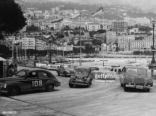 The Monte Carlo Rally Monaco 1954 The cars race along the sea front They are No 108 a 1290cc contemporary Peugeot 203 No 30 a c1952 850cc Packard...