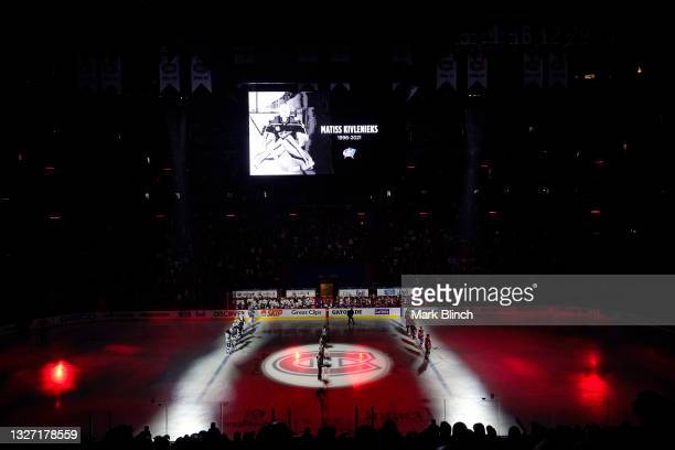 The Montreal Canadiens and the Tampa Bay Lightning stand on the ice during a moment of silence for Columbus Blue Jackets goalie Matiss Kivlenieks...