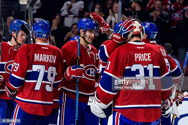 The Montreal Canadiens celebrate a victory over the Arizona Coyotes during the NHL game at the Bell Centre on October 20 2016 in Montreal Quebec...