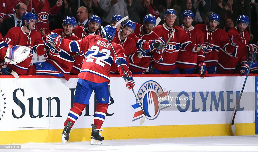The Montreal Canadiens celebrate after the goal of Dale Weise #22 against the New York Rangers in the NHL game at the Bell Centre on October 15, 2015 in Montreal, Quebec, Canada.