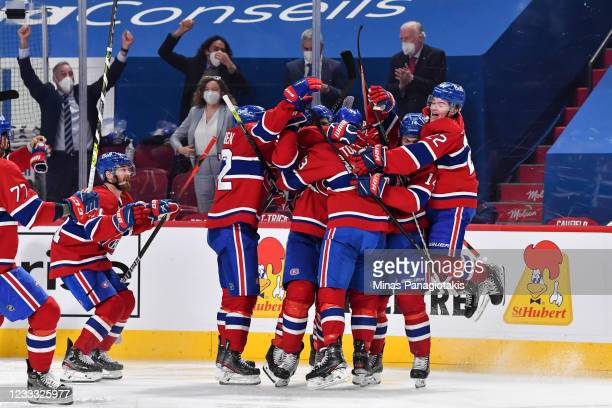 The Montreal Canadiens celebrate an overtime victory against the Winnipeg Jets in Game Four of the Second Round of the 2021 Stanley Cup Playoffs at...