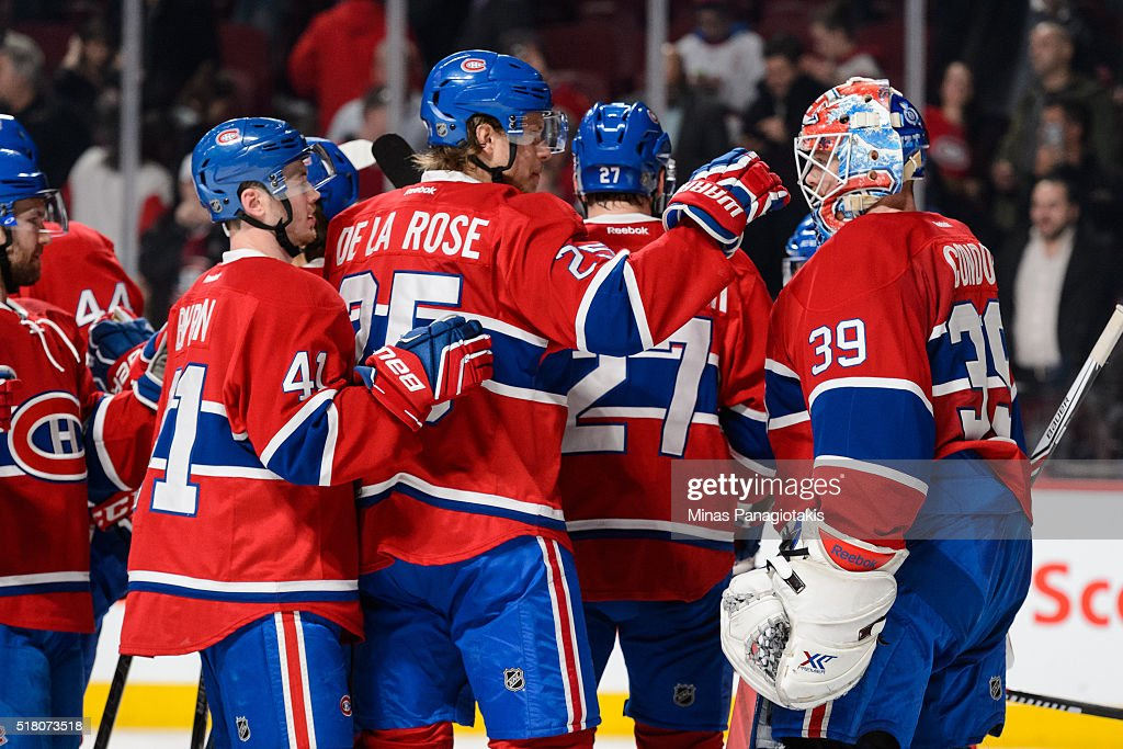 The Montreal Canadiens celebrate their victory over the Detroit Red Wings during the NHL game at the Bell Centre on March 29, 2016 in Montreal, Quebec, Canada. The Montreal Canadiens defeated the Detroit Red Wings 4-3.