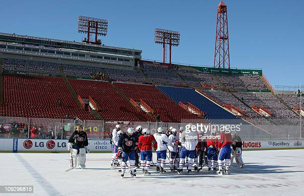The Montreal Canadiens huddle during practice for the 2011 Tim Hortons Heritage Classic at McMahon Stadium on February 19 2011 in Calgary Alberta...