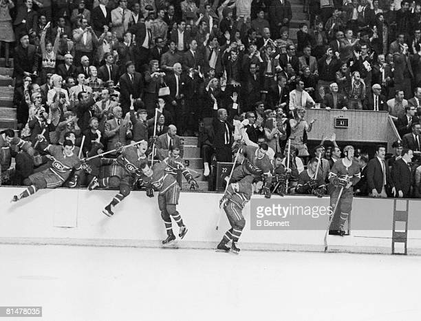 The Montreal Canadiens leap over the boards in celebration after they defeated the St. Louis Blues in the last game of the Stanley Cup finals,...
