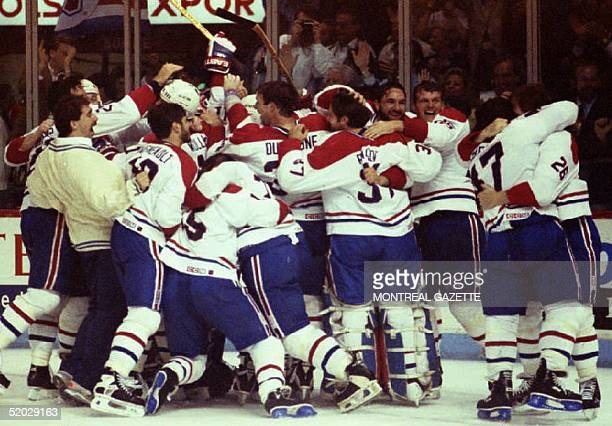 The Montreal Canadiens meet on the ice to celebrate their Stanley Cup victory 09 June 1993 The Canadiens won their 24th Stanley Cup championship by...