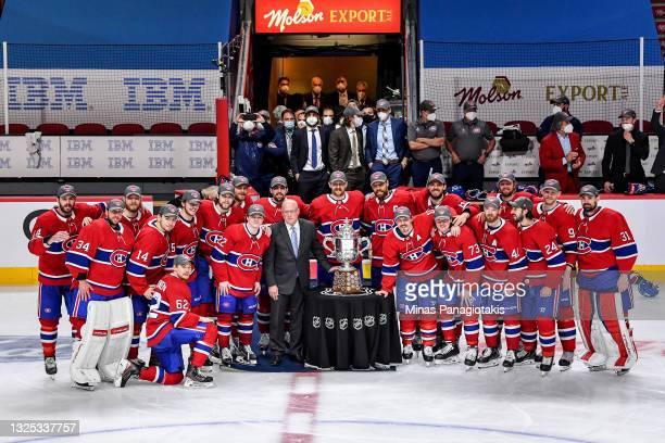 The Montreal Canadiens pose with the Clarence S. Campbell Bowl after defeating the Vegas Golden Knights 3-2 during the first overtime period in Game...