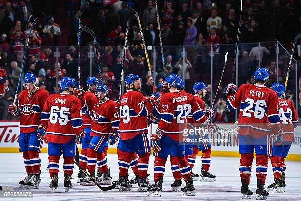 The Montreal Canadiens raise their sticks thanking the crowd after defeating the Boston Bruins during the NHL game at the Bell Centre on November 8...