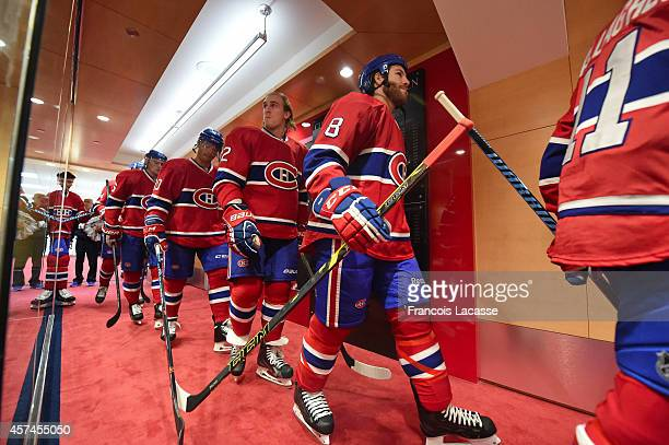 The Montreal Canadiens take the ice for pregame warmups prior to a game against the Colorado Avalanche in the NHL game at the Bell Centre on October...