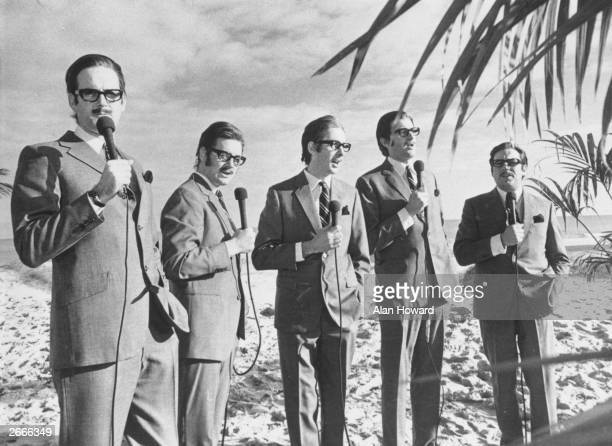 The Monty Python team imitate journalist and broadcaster Alan Whicker Left to right John Cleese Michael Palin Eric Idle Graham Chapman and Terry Jones