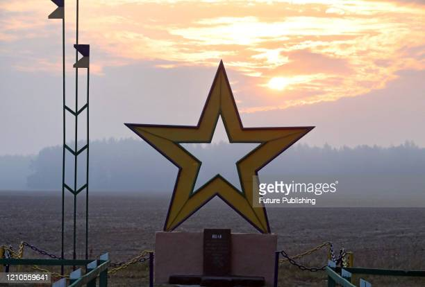 The monument featuring the star is seen on the outskirts of Maksymovychi village as the region suffers from smoke coming from fires in Kyiv and...