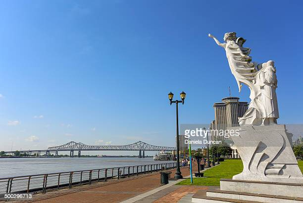 The Monument to the Immigrant on the bank of the Mississippi River, Woldenberg Park, New Orleans.