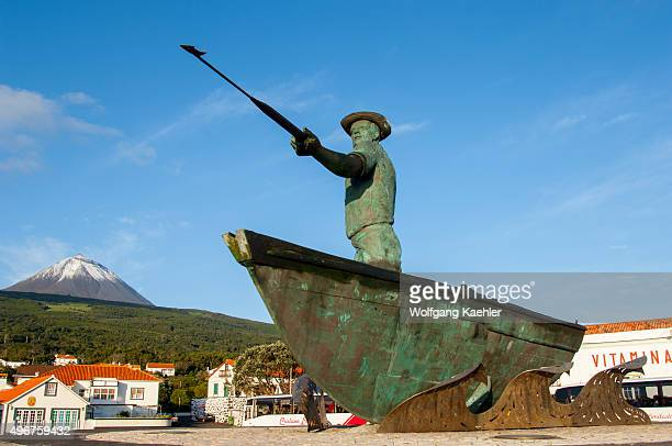 The monument to the whalers at the whaling museum in Sao Roque do Pico on Pico Island in the Azores Portugal with Pico Volcano in the background