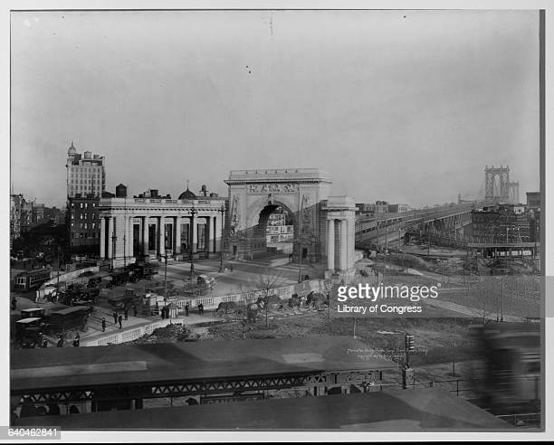 The monumental entrance of the Manhattan Bridge designed by Carrere and Hastings, at the intersection of Canal Street and Bowery Street . A commuter...