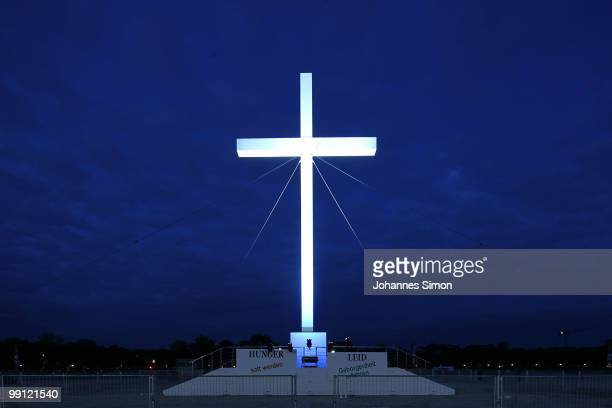 The monumental main cross, symbolizing the Christian faith, is illuminated during dusk of day 1 of the 2nd Ecumenical Church Day at the...