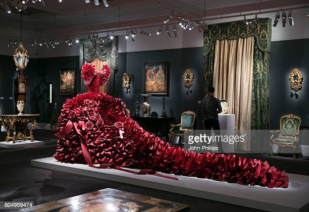 The monumental red paper dress sculpture by British Artist Zoe Bradley is unveiled along side Royal and Aristocratic Heirlooms at Sotheby's on...