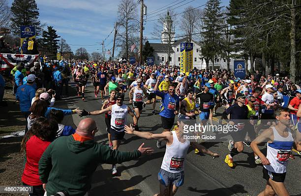 The mood was cheerful and energetic as jubilant runners received high fives at the start of the 118th Boston Marathon on Monday April 21 2014