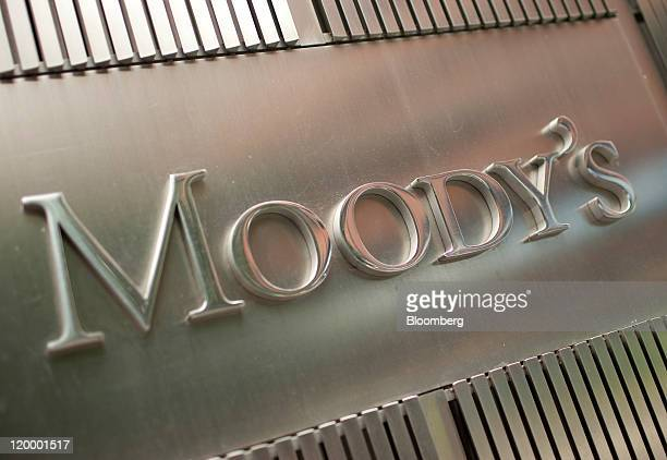 The Moody's Investors Service Inc logo is displayed outside of the company's headquarters in New York US on Thursday July 28 2011 Moody's Investors...