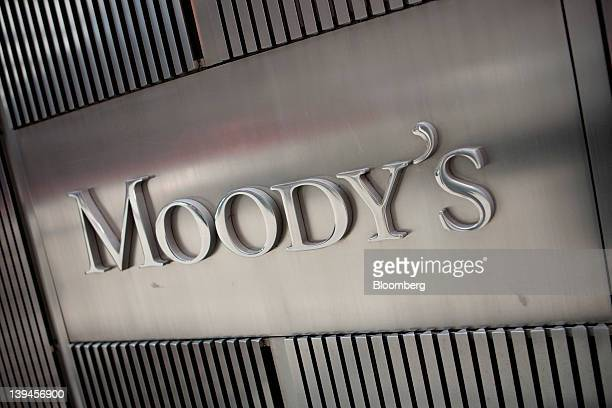 The Moody's Investors Service Inc logo is displayed outside of the company's headquarters in New York US on Tuesday Feb 21 2012 Moody's Corp is a...