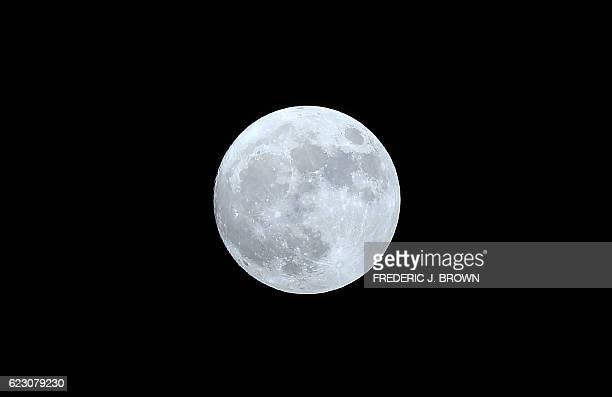 TOPSHOT The moon as seen over Monterey Park east of downtown Los Angeles on November 13 some seven hours before the socalled Super Moon becomes not...