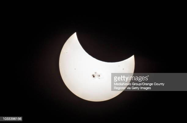 The moon at right covers part of the sun during partial solar eclipse as seen from the campus of Cal State Fullerton on Tuesday Oct 23 2014 The image...