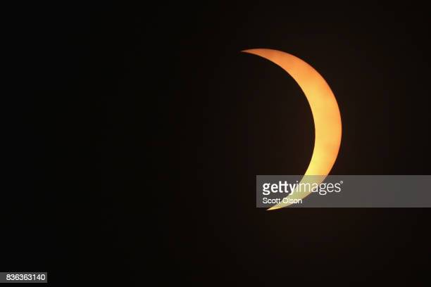 The moon eclipses the sun above the campus of Southern Illinois University on August 21 2017 in Carbondale Illinois Although much of it was covered...
