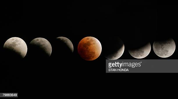 The moon enters and emerges from the earth's shadow during a total eclipse of the moon on February 20 2008 over in Titusville Florida in this...