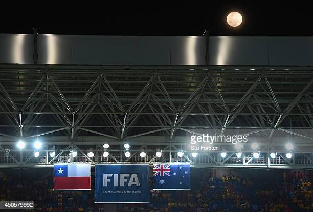 The moon glows above the stadium during the 2014 FIFA World Cup Brazil Group B match between Chile and Australia at Arena Pantanal on June 13 2014 in...