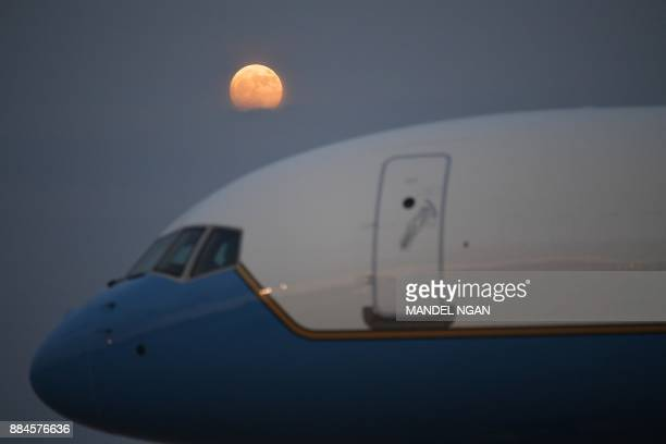The moon is seen above Air Force One at Andrews Air Force Base in Maryland on December 2 2017 Trump is returning to Washington DC after attending...