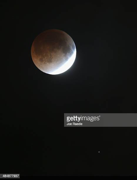 The moon is seen as it heads into a total lunar eclipse on April 15 2014 in Miami Florida People in most of north and south America should be able to...