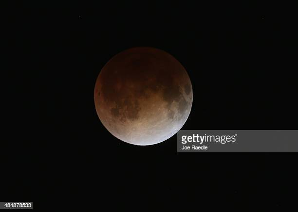 The moon is seen as it nears a total lunar eclipse on April 15 2014 in Miami Florida People in most of north and south America should be able to...