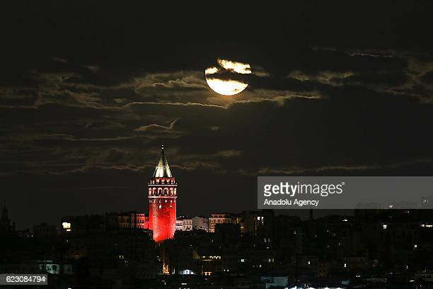 The moon is seen behind of the Galata tower in Istanbul Turkey on November 13 2016 Super Moon becomes the closest full moon of the 21st century
