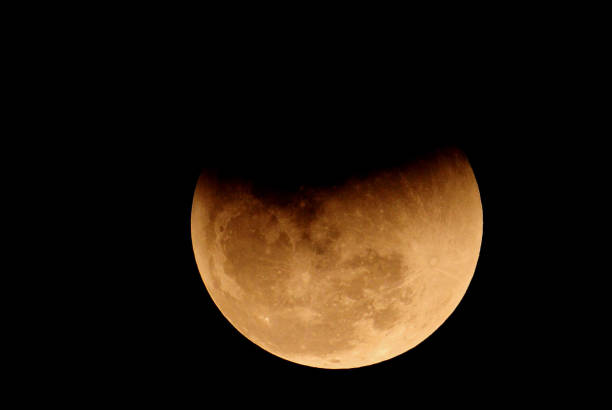 The moon is seen during a lunar eclipse on January 31 2018 in Chandigarh India In rare celestial event a supermoon blue moon and Total Lunar Eclipse..