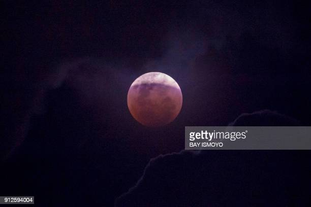 The moon is seen during a lunar eclipse referred to as the 'super blue blood moon' in Jakarta on January 31 2018 Skywatchers were hoping for a rare...